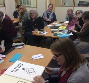 Attendees at the event looking at examples of artists books