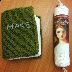 Book with a green knitted cover and sausage-shaped Wuthering Heights
